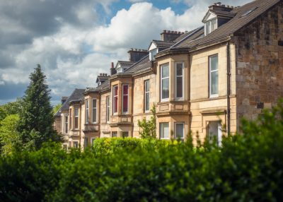 Row of residential houses, market shows strong momentum.